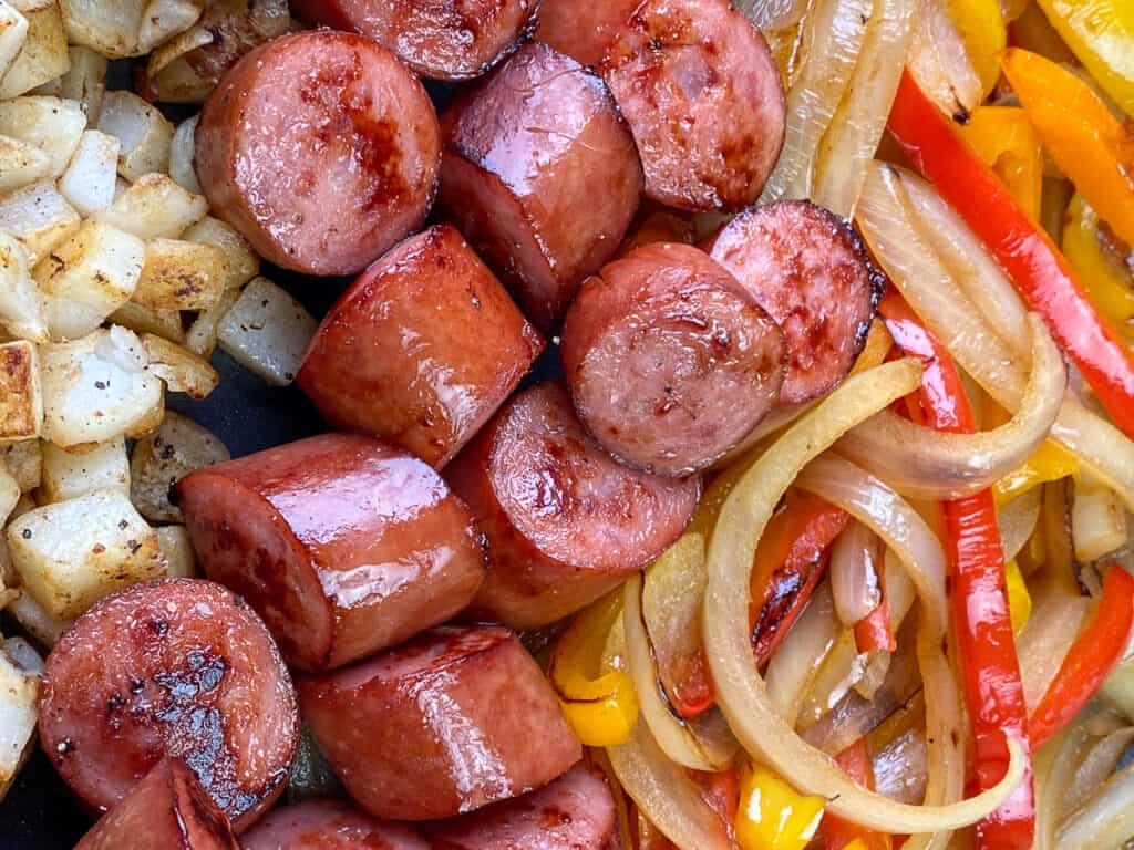 Veggie, potato and smoked sausage skillet very close up