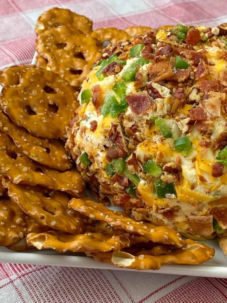 So many flavors form the crust include a variety of cheeses, pecans, green onions and bacon combine with jalapenos to make the best cheese ball