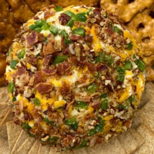 Easy cheeseball flavored with chopped jalapenos, crumbled bacon and shredded cheeses