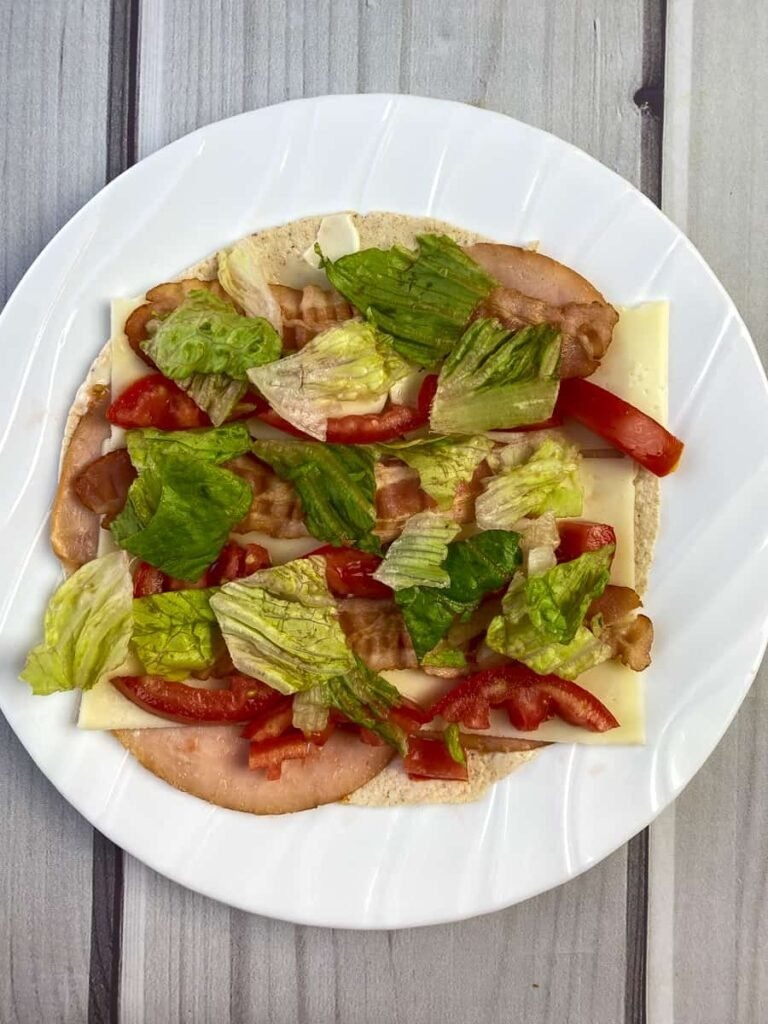 Lettuce on bacon and tomato wrap
