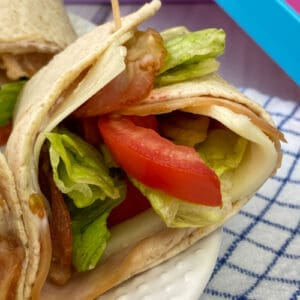 Tomato slice, lettuce, bacon, turkey and cheese in an easy wrap for lunch