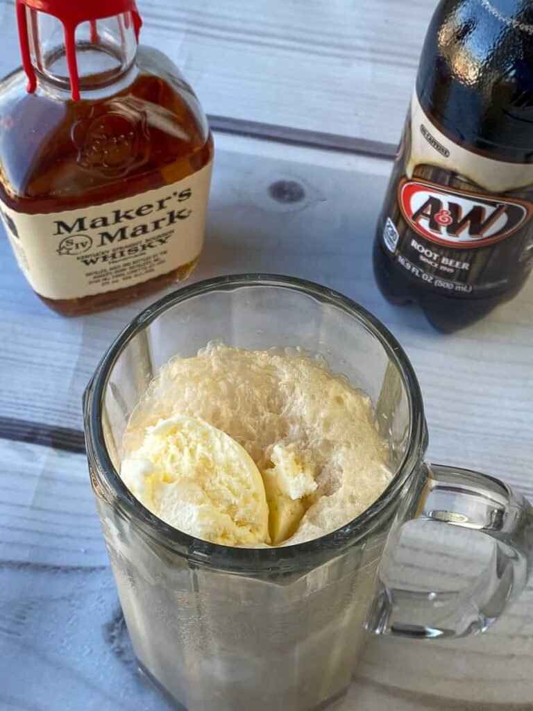 Mug with an adult root beer float with whiskey added