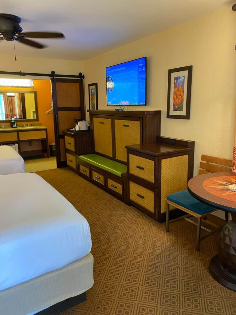 Fold out bed under tv in Disney hotel room
