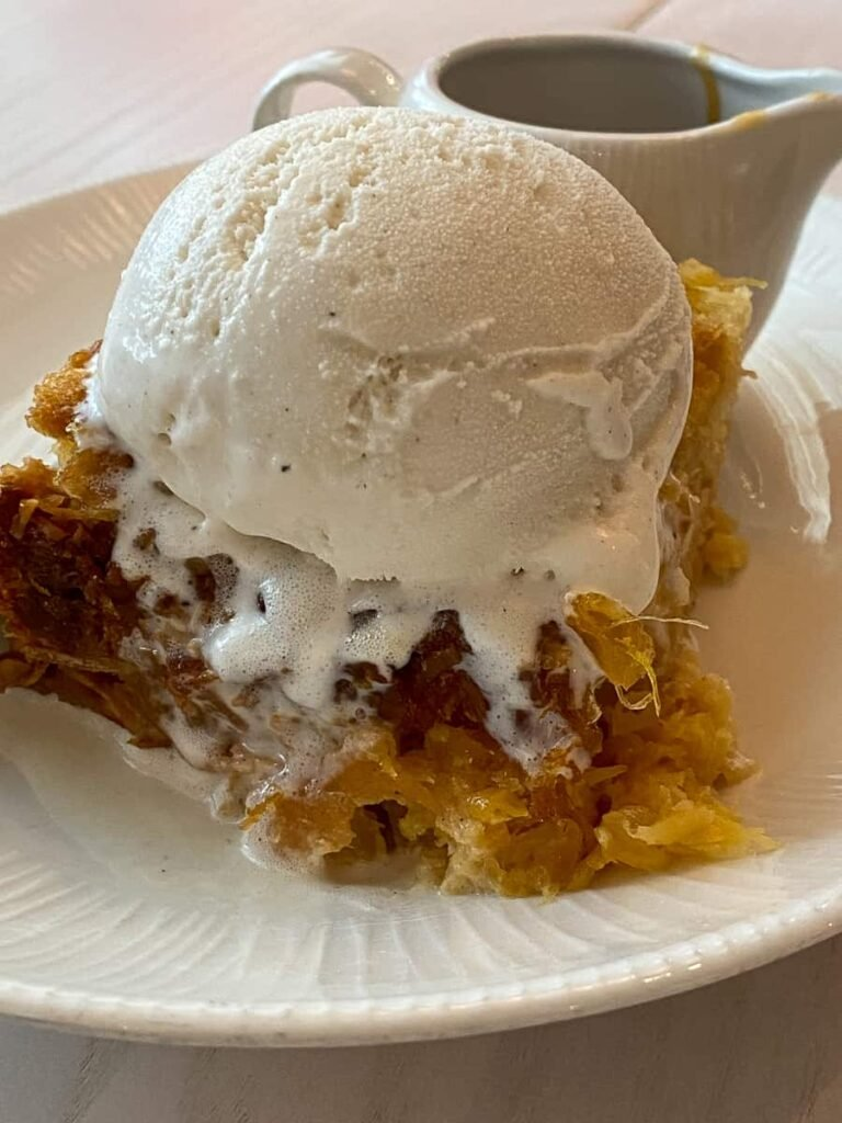 Coconut pineapple bread pudding with vanilla ice cream and caramel sauce
