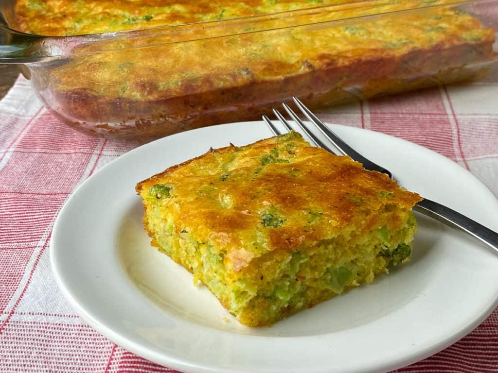 Moist and tender piece of broccoli cornbread on a plate