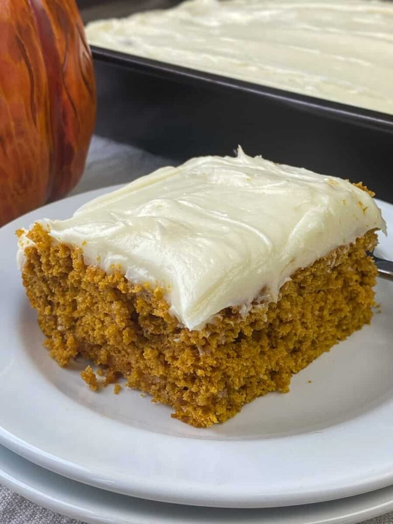 Piece of the best pumpkin carrot cake with frosting