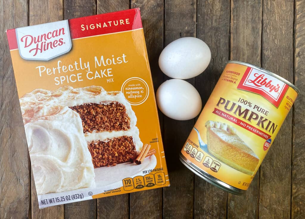 Box of cake mix, can of pumpkin and eggs