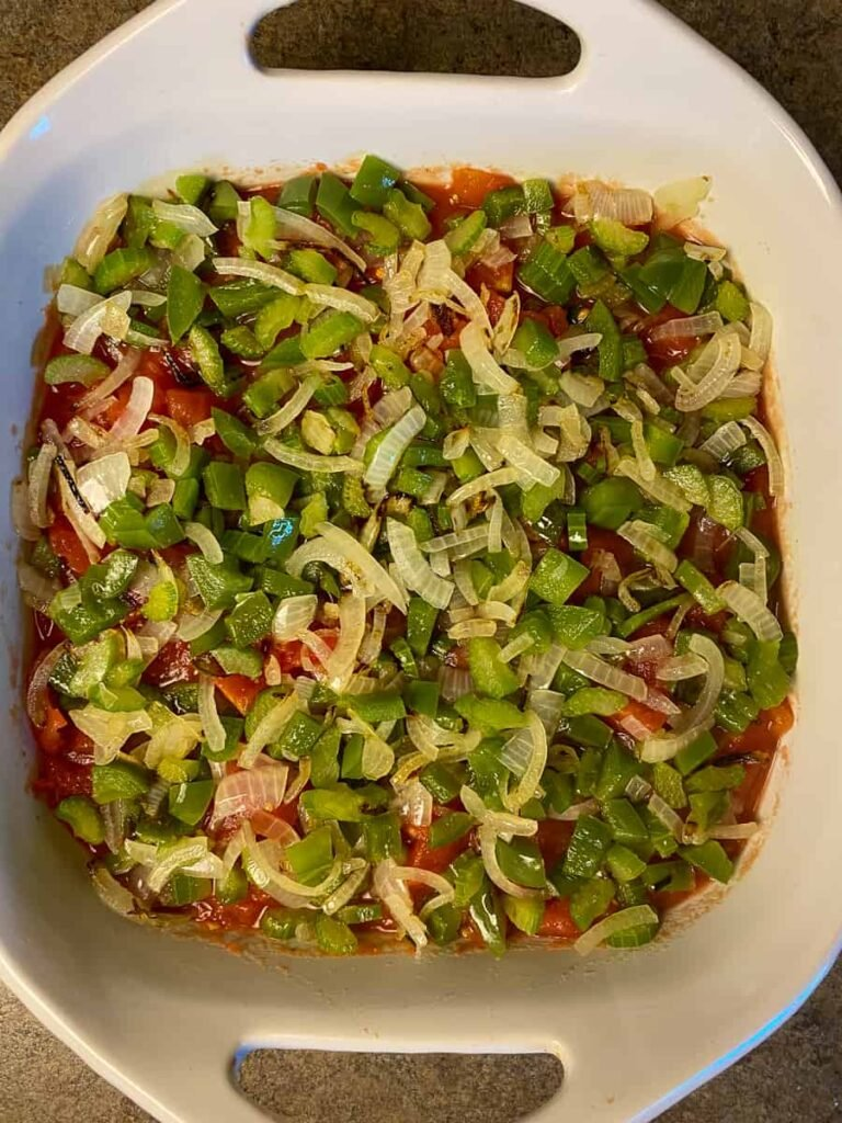 Green peppers and onions spread on scalloped tomatoes recipe
