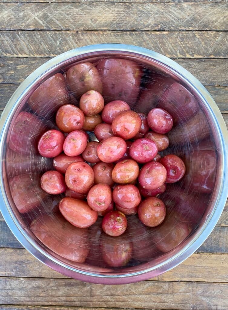 Baby red potatoes with light coat of olive oil in a bowl