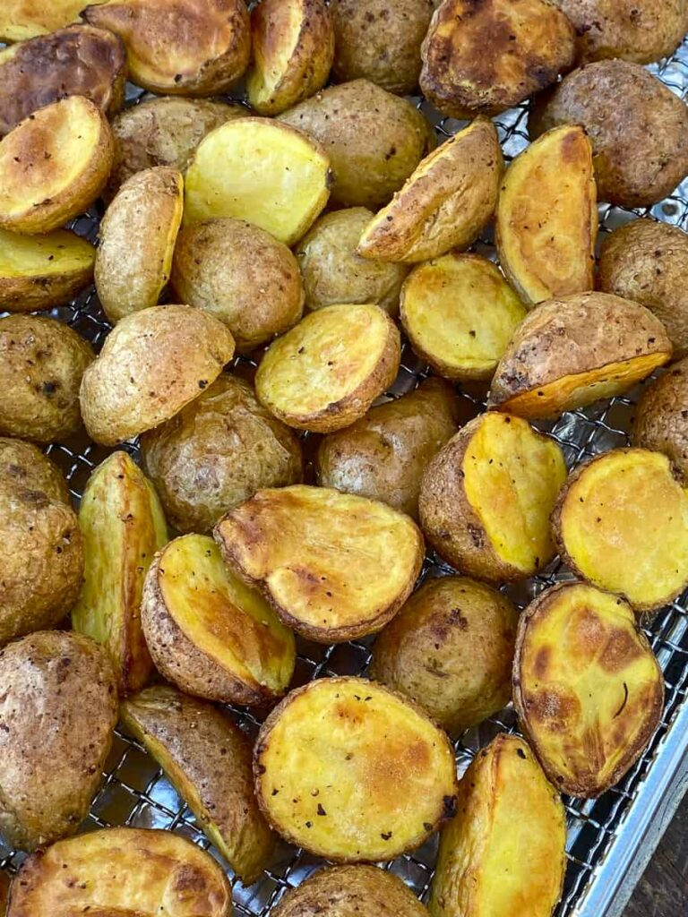 Halved baby potatoes and air fried on air fryer tray