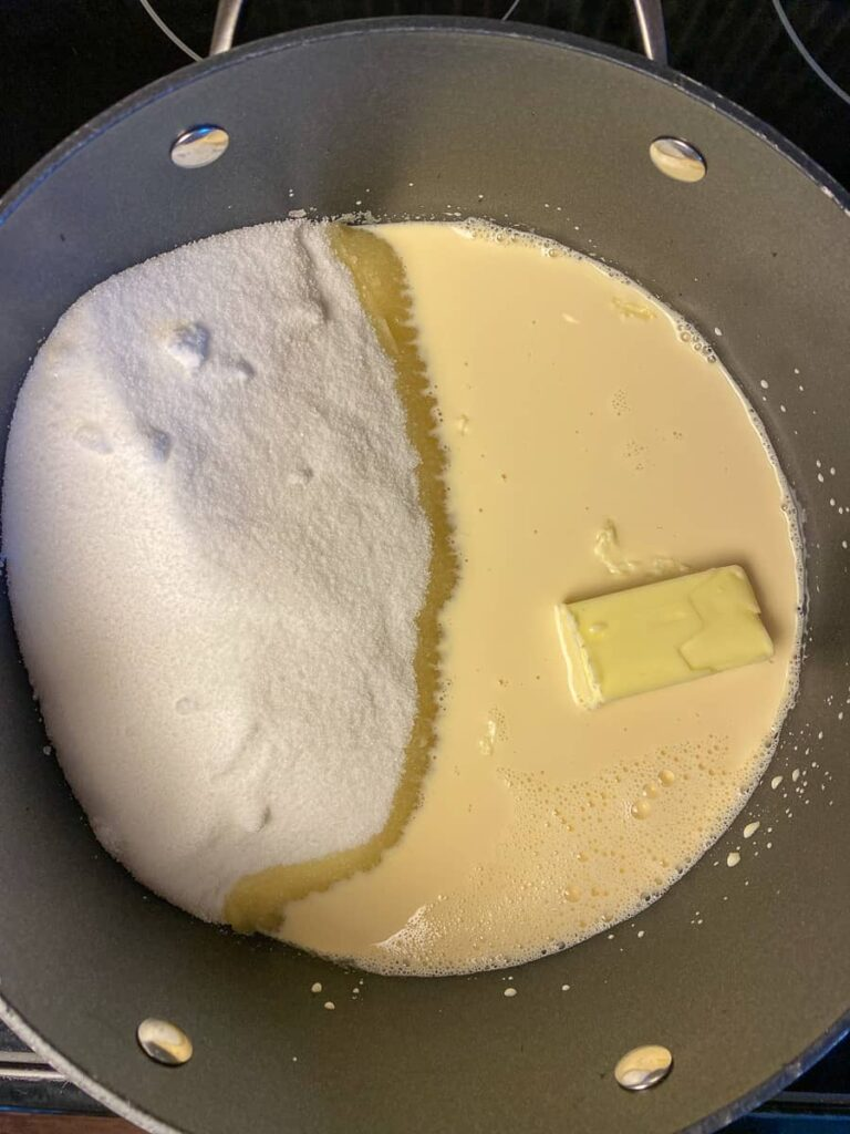 Butter, evaporated milk and sugar in pan